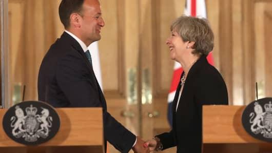 LONDON, ENGLAND - JUNE 19:  Britain's Prime Minister Theresa May (R) and Irish Taoiseach Leo Varadkar shake hands at a joint press conference.
