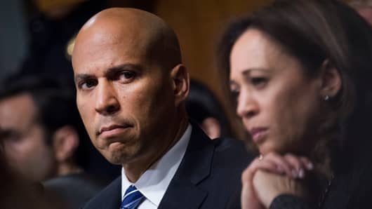 Sen. Cory Booker, D-N.J.,  and Sen. Kamala Harris, D-Calif., listen as Dr. Christine Blasey Ford testifies during the Senate Judiciary Committee hearing on the nomination of Brett M. Kavanaugh to be an associate justice of the Supreme Court of the United States, focusing on allegations of sexual assault by Kavanaugh against Christine Blasey Ford in the early 1980s.