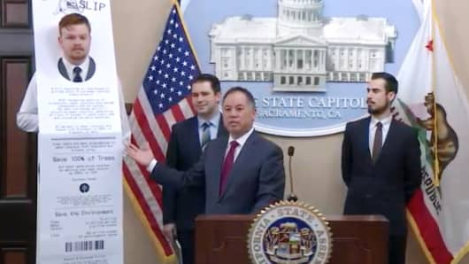 "California Assemblymember Phil Ting (D-San Francisco), holding press conference at State Capitol in Sacramento Jan. 8, 2019, to discuss new ""Skip the Slip"" legislation to reduce waste that would mandate retailers offer electronic receipts unless customers ask specifically for a paper receipt."