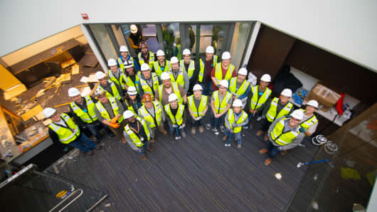 Microsoft employees and contractors pose for a photo in the company's Building 2 as demolition begins.