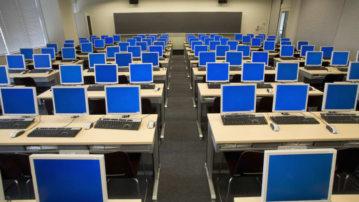 Rows of computers in classroom