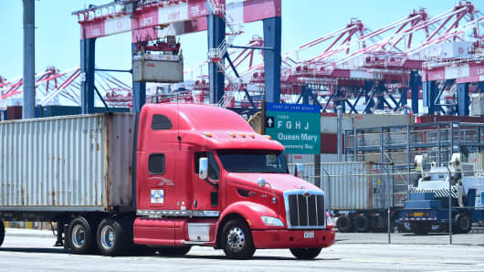 A container delivery truck heads for one of the terminals at the Port of Long Beach in Long Beach, California.