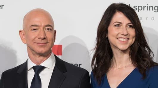 Head of Amazon Jeff Bezos and his wife MacKenzie Bezos arrive for the Axel Springer award ceremony.