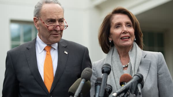Speaker of the House Nancy Pelosi and Senate Democratic Leader Chuck Schumer speak to the media following a meeting with US President Donald Trump about the partial government shutdown at the White House in Washington, DC, January 9, 2019.