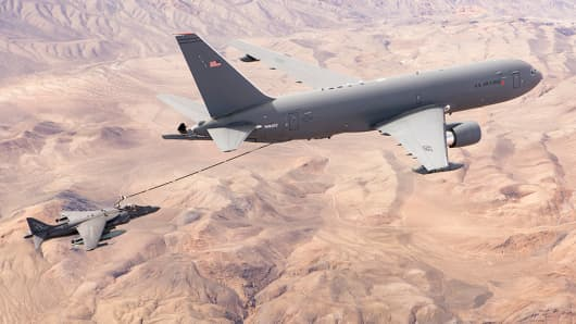 Boeing's KC-46 aerial refueling tanker delivers fuel to a jet.