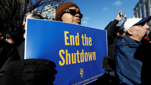 """Federal government employees, contract workers and other demonstrators march during a """"Rally to End the Shutdown"""" in Washington, January 10, 2019."""
