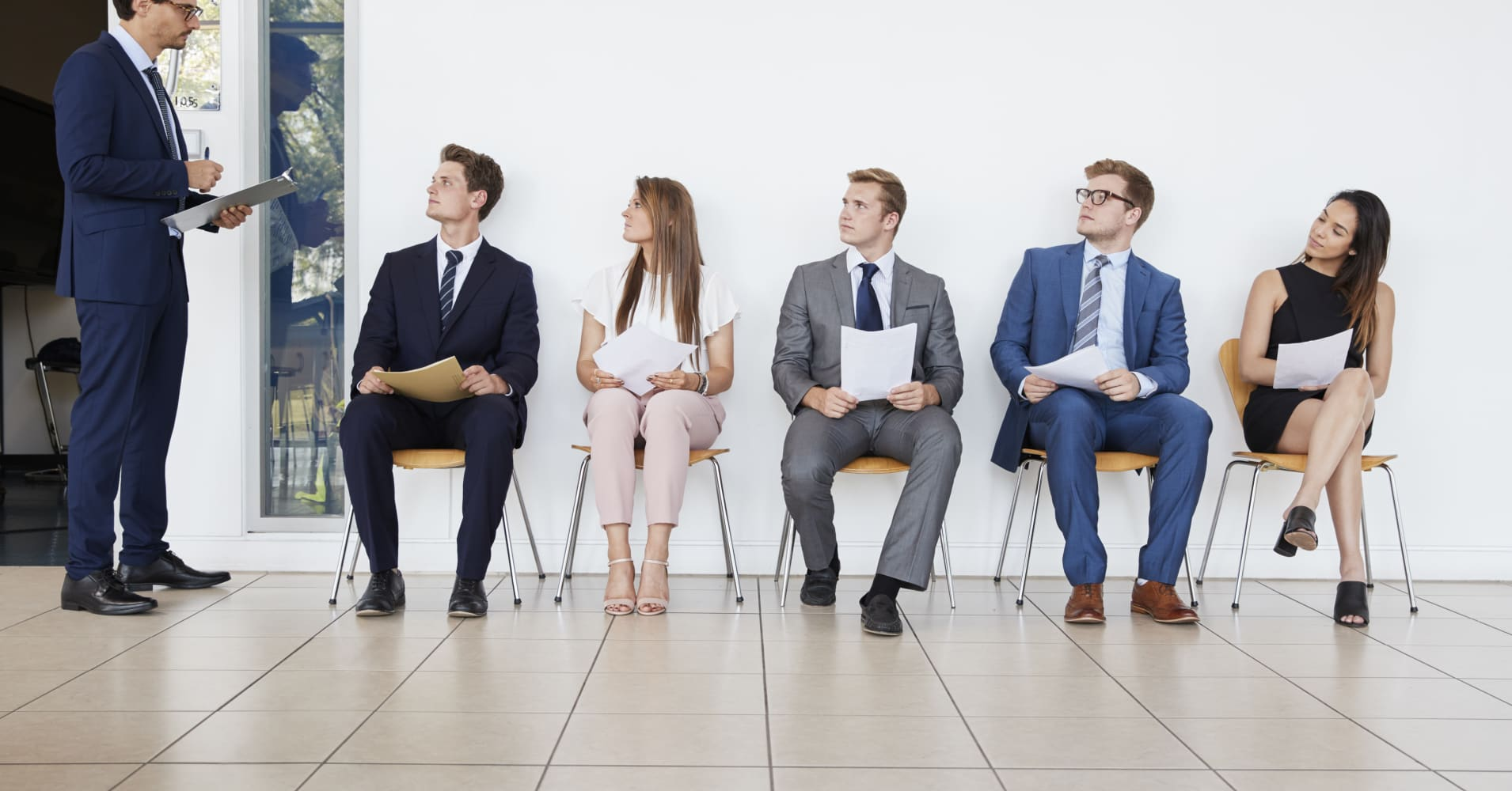 Recruiter and people waiting for job interviews, full length
