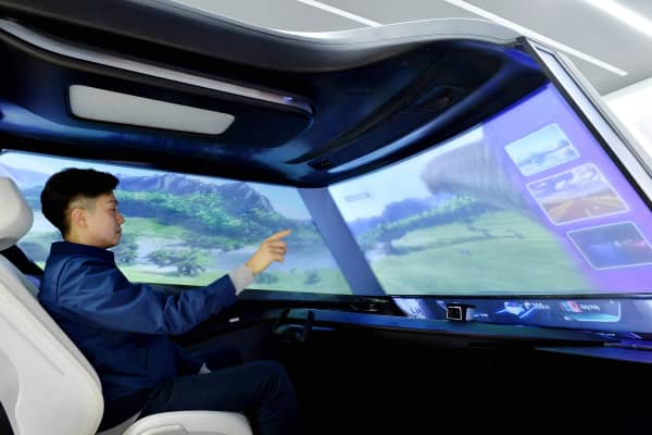 "An interior view of a Hyundai Mobis autonomous concept car with gesture-based ""virtual touch."""