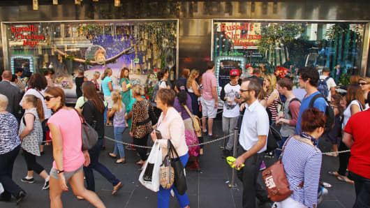 People walk past the Myer Christmas window display as they do their  shopping on December 20, 2012 in Melbourne, Australia.