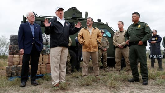 President Donald Trump speaks to reporters as he visits the banks of the Rio Grande River with Senator John Cornyn (R-TX), Senator Ted Cruz (R-TX) and U.S. Customs and Border Patrol agents during the president's visit to the U.S. - Mexico border in Mission, Texas, January 10, 2019.