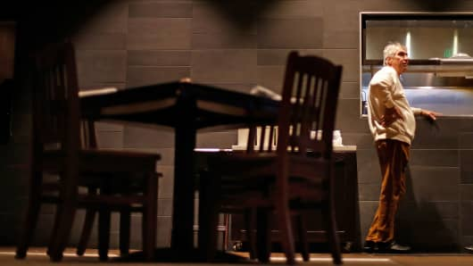 Michael Northern, vice president of WJP Restaurant Group, stands next to an empty table at dinnertime at Rocket City Tavern near numerous federal agencies in Huntsville, Ala., Wednesday, Jan. 9, 2019.