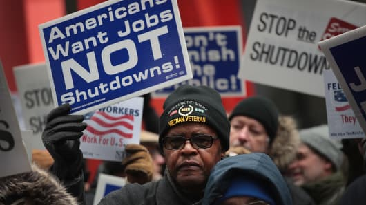 Government workers protest the government shutdown during a demonstration in the Federal Building Plaza on Jan. 10, 2019 in Chicago, Illinois.