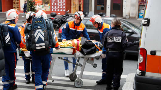 PARIS, FRANCE - JANUARY 12: An injured person is stretchered away as emergency services attend a huge explosion which occurred in a bakery in Rue de Trévise in the 9th Arrondissement on January 12, 2019 in Paris, France.