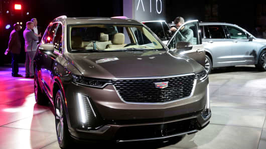 Members of the media look at General Motors 2020 Cadillac XT6 SUV after it was revealed on the eve of press days of the North American International Auto show in Detroit, Michigan, January 13, 2019.