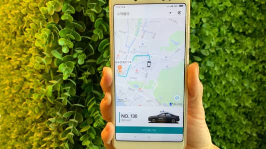 Pony.ai's driverless car taxi app in action.