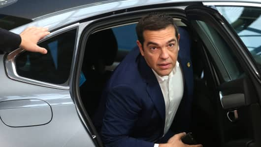Greek Prime Minister Alexis Tsipras gets out his car as he arrives at the European Council in Brussels on October 18, 2018.