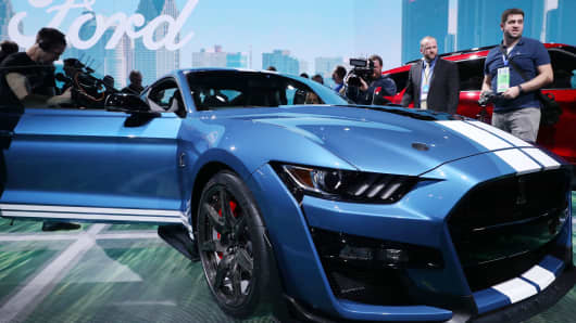 Members of the media look over the 2020 Ford Mustang Shelby GT500 after it was revealed at the North American International Auto Show in Detroit, Michigan, January 14, 2019.