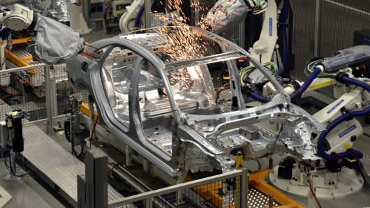 Robot machines weld a Volkswagen at the body shop in company's factory in Chattanooga, Tennessee.