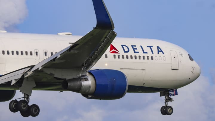 A Delta Air Lines Boeing 767-300 landing in Amsterdam.