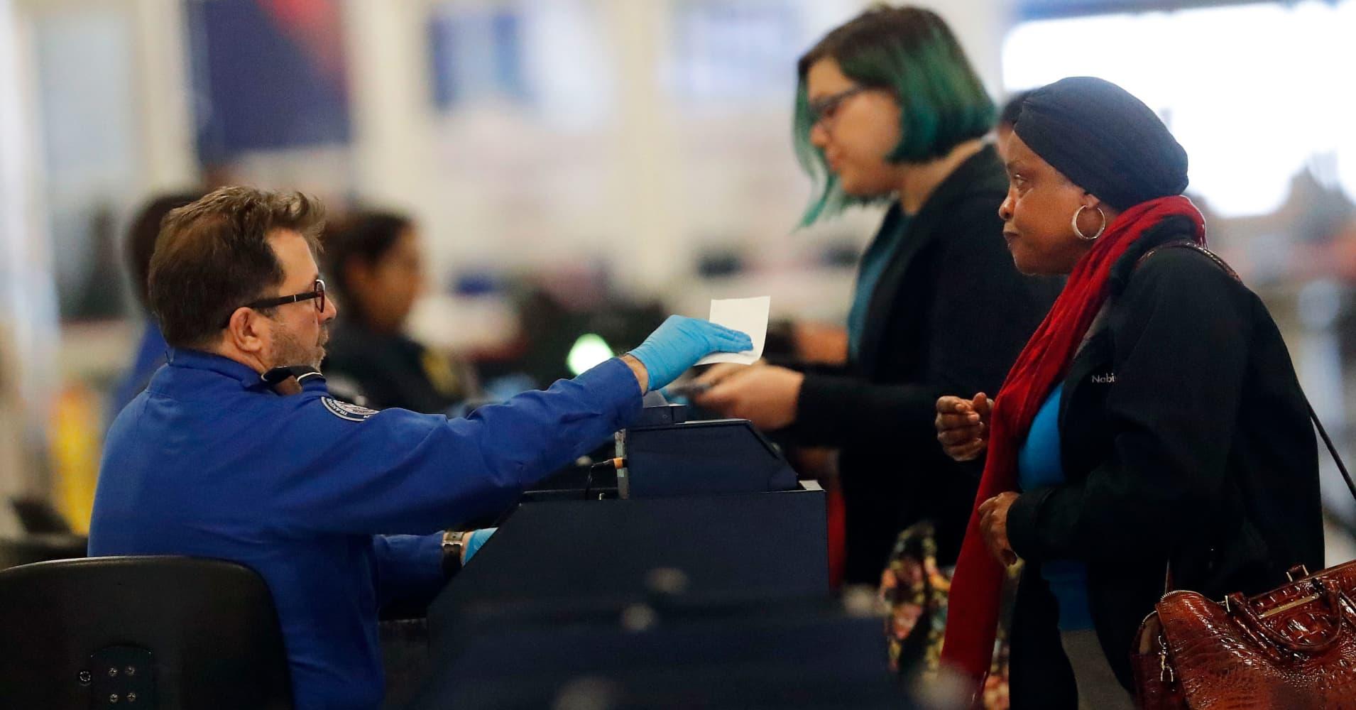 Passengers face long lines, closed checkpoints as unpaid TSA screeners call in sick amid shutdown