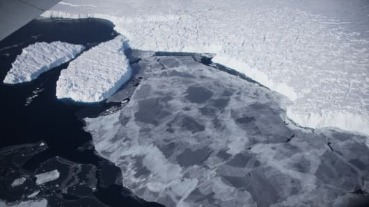 Ice floats near the coast of West Antarctica as viewed from a window of a NASA Operation IceBridge airplane on October 28, 2016 in-flight over Antarctica.