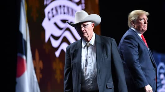 Arizona farmer Jim Chilton leaves after shaking hands with US President Donald Trump  during the annual American Farm Bureau Federation convention in the Ernest N. Morial Convention Center in New Orleans, Louisiana on January 14, 2019.