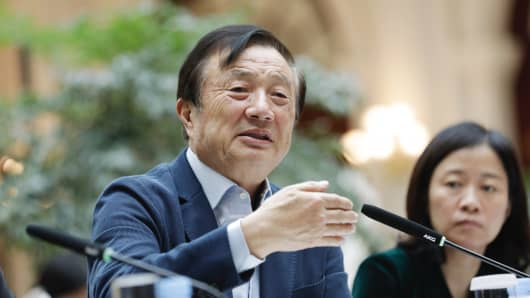 Ren Zhengfei, founder and chief executive officer of Huawei Technologies, left, speaks during an interview at the company's headquarters in Shenzhen, China, in January.