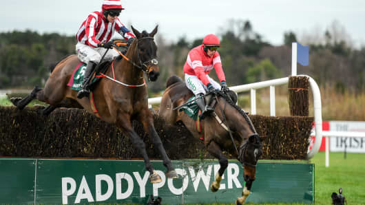 Paloma Blue, left, with Mark Walsh up, on their way to winning as Real Steel, right, with Paul Townsend up, falls at the last, during the Paddy Power 'Live Stream All Irish Racing On Our App' Beginners Steeplechase during day two of the Leopardstown Festival at Leopardstown Racecourse in Dublin. (Photo By Eóin Noonan/Sportsfile via Getty Images)