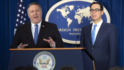 Secretary of State Mike Pompeo, left, and Treasury Secretary Steven Mnuchin, present details of the new sanctions on Iran, at the Foreign Press Center in Washington, Monday, Nov. 5, 2018.