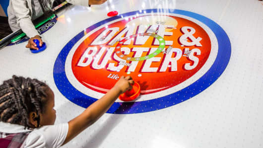 Signage is displayed in the middle of a air hockey table at a Dave & Buster's Entertainment location in Pelham, New York.