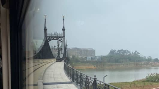 This bridge is a replica or the Freedom Bridge found in Budapest, Hungary. The tram that runs through the campus crosses this bridge.
