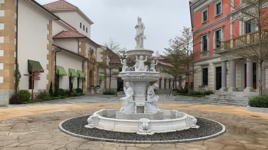 """A fountain in the middle of one of the """"towns"""" on Huawei's brand new campus in Dongguan, south China."""