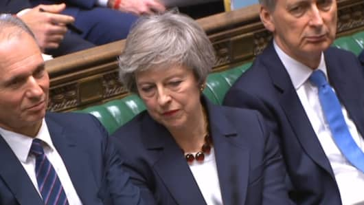 Prime Minister Theresa May listens in the House of Commons, London.
