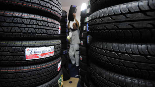 An employee works at a tire store in Hefei, China.