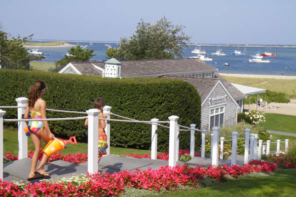 A girl and boy walking down the steps at Aunt Lydia's Cove, Chatham Bars Inn, Cape Cod.