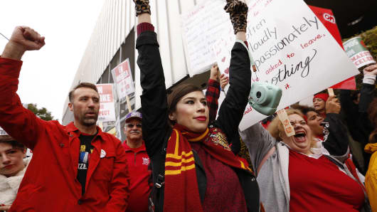 Marua Corona, center, a High School teacher at The Accelerated Schools, a community of public charter schools in South Los Angeles joins fellow teachers as they picket outside the school on second day of the Los Angeles school teachers strike on January 15, 2019 in Los Angeles, California.
