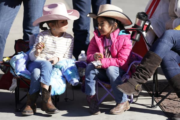 Children in cowboy hats wait for the  National Western Stockshow parade on Jan. 4, 2018 in Denver, Colorado.