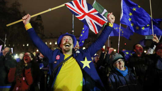 An anit-Brexit demonstrator reacts to the result of the vote on the Brexit deal in London, U.K., on Tuesday, Jan. 15, 2019.