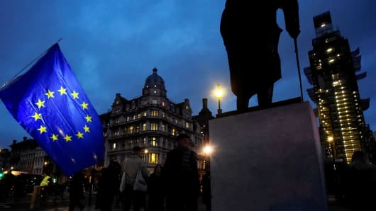 An EU flag flutters next to the statue of Winston Churchill outside the Houses of Parliament, ahead of a vote on Prime Minister Theresa May's Brexit deal, in London, Britain January 15, 2019.