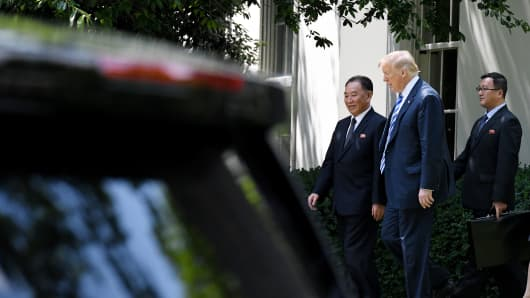 U.S. President Donald Trump (2-R)  walks with Kim Yong Chol, former North Korean military intelligence chief and one of leader Kim Jong Un's closest aides, on the South Lawn of the White House on June 1, 2018 in Washington, DC.