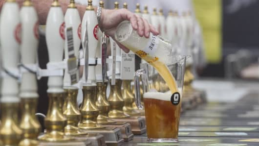 Hundreds of visitors sample 900 different real ales, craft beers international beers, ciders at the CAMRA Great British Beer Festival at Olympia London exhibition center on August 08, 2017 in London, England.