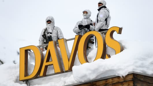 Armed security personnel stand guard on the rooftop of a hotel in Davos, Switzerland.
