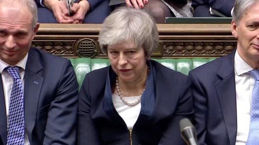 Prime Minister Theresa May sits down in Parliament after the vote on May&#039;s Brexit deal, in London, Britain,...</div></div><div class=