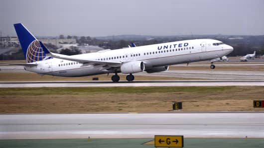 A United Airlines Boeing 737 passenger jet takes off at San Antonio International Airport in Texas.
