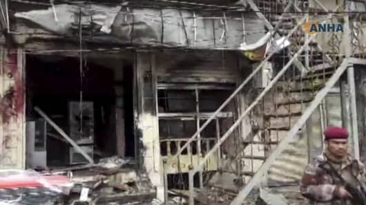This frame grab from video provided by Hawar News, ANHA, the news agency for the semi-autonomous Kurdish areas in Syria, shows a damaged restaurant where an explosion occurred, in Manbij, Syria, Wednesday, Jan. 16, 2019.