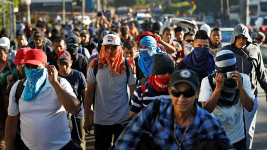 Salvadorans take part in a new caravan of migrants, set to head to the United States, as they leave San Salvador, El Salvador January 16, 2019.