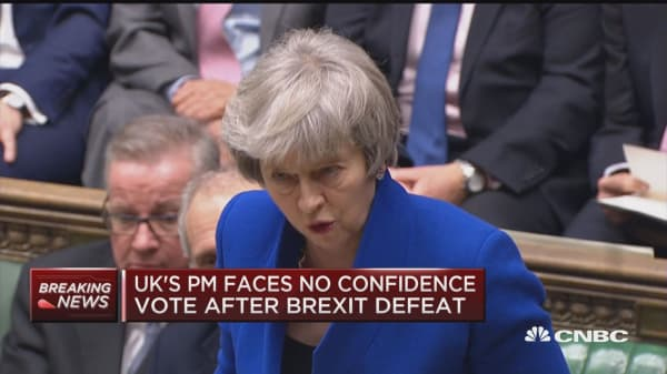 UK Prime Minister Theresa May speaks after surviving no-confidence vote
