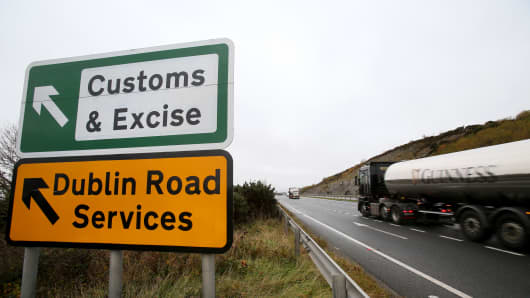 A main road outside Newry, Northern Ireland that shows an old customs and excise station near the border between Northern Ireland and Ireland.