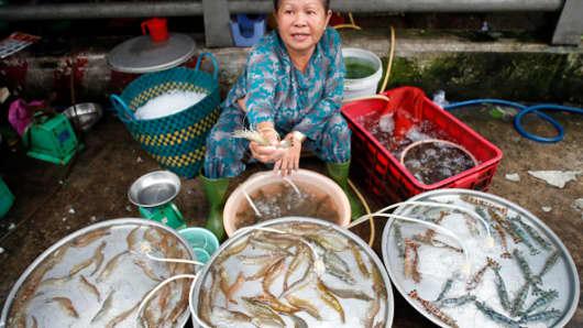 A woman sells shrimp at a street market in Ho Chi Minh City, Vietnam.