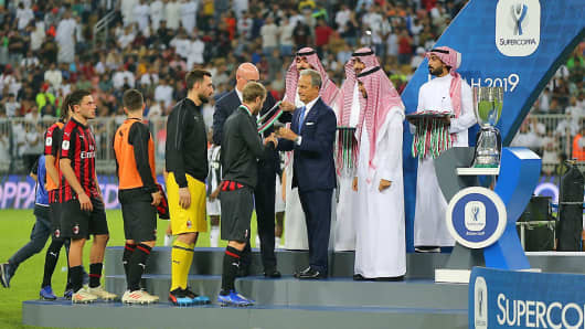 AC Milan' players receive medals following their Supercoppa Italiana final match against Juventus at the King Abdullah Sports City Stadium in Jeddah on January 16, 2019.